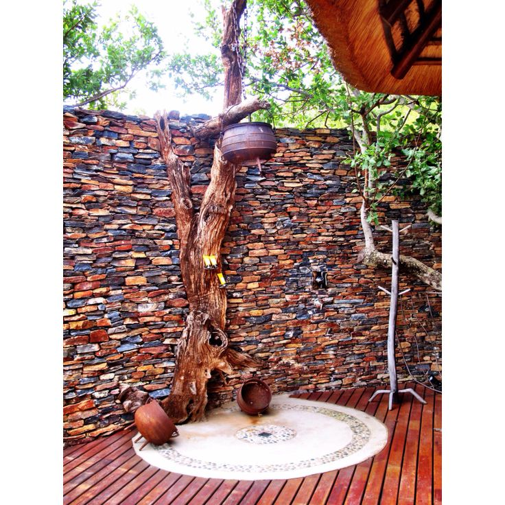 Outdoor shower in the middle of the bush in Botswana at Molori Safari Lodge, South Africa
