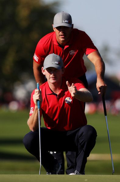 Brooks Koepka and Brandt Snedeker of the United States line up a putt on the 11th green during afternoon fourball matches of the 2016 Ryder Cup at Hazeltine National Golf Club on September 30, 2016 in Chaska, Minnesota. - 339 of 595