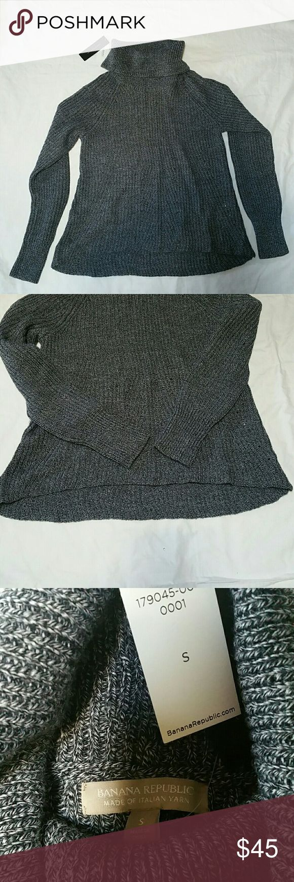 NWT Banana Republic, Italian Yarn Sweater, size S Turtle neck sweater made of Italian yarn, believe it's from their 2014 line. Approximately retail is $120.  The front is slightly shorter than the back hem.  Looks grey  in the 1st picture, but in the last picture, it shows its actually made of black and white yarn Banana Republic Sweaters Cowl & Turtlenecks