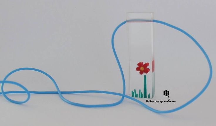 Flower scene, carved into plexiglass and filled with UV resin.