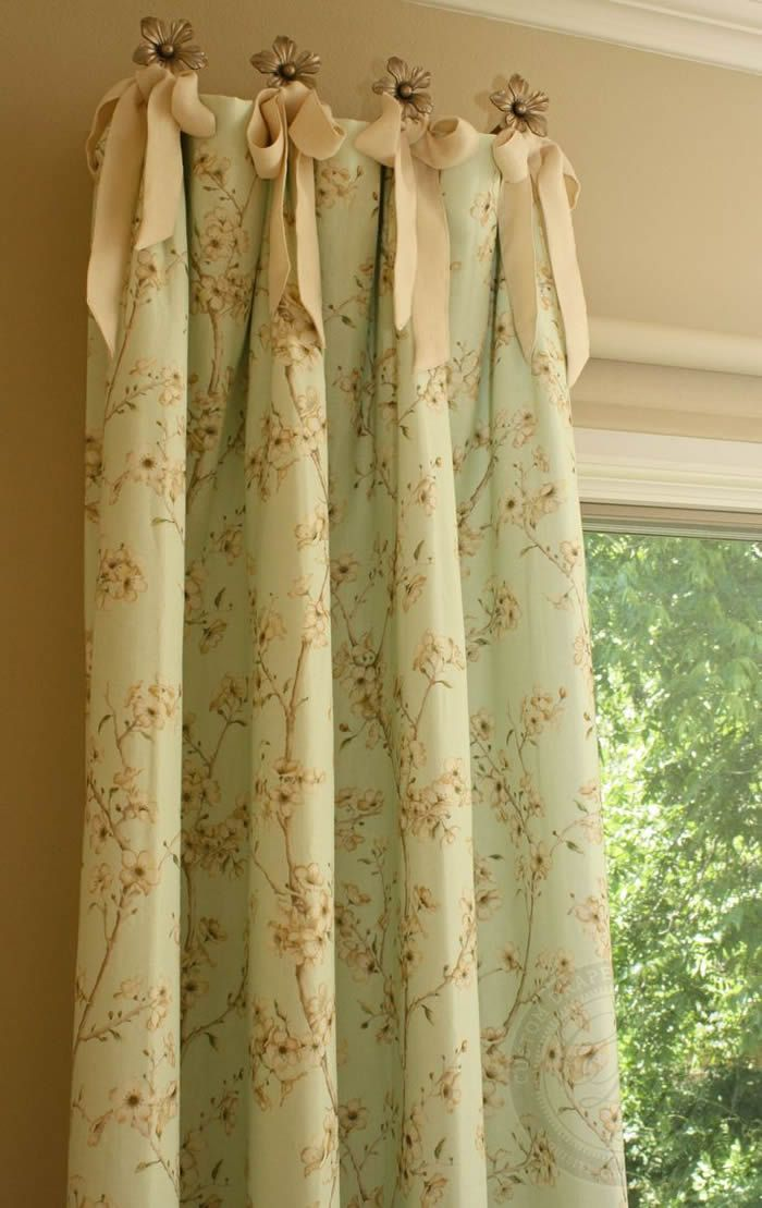 Curtain Panels - tied to stationary knobs, these panels stay at either end of the window or door, while a second curtain can be drawn for privacy - via Adriana Home Furnishings