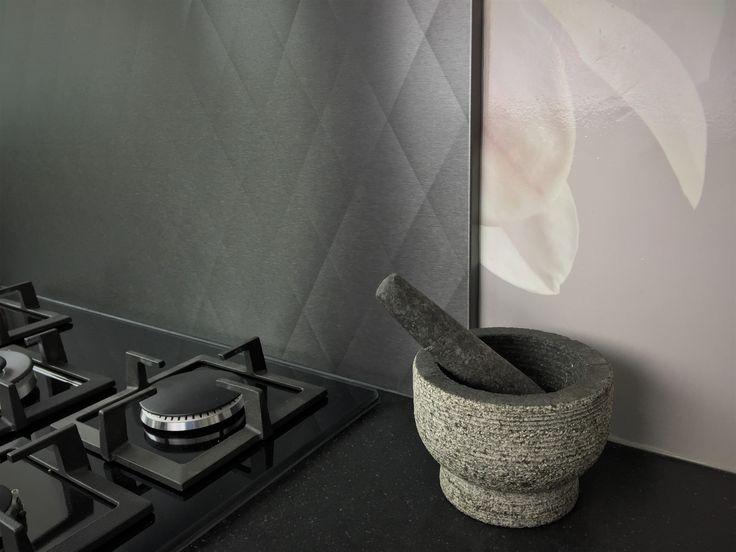 Black stainless steel backsplash with diamond patern