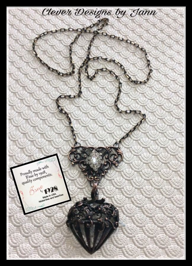 B'sue by 1928 Rusty Iron Pewter Heart is used in the necklace along with another B'sue Component and a vintage rhinestone earring .. Clever Designs by Jann .. Sold