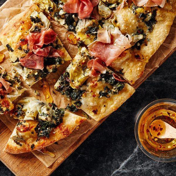 Artichoke, Spinach, and Prosciutto Flatbreads With Spicy Honey