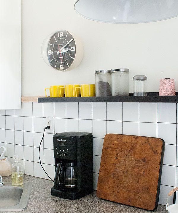 backsplash. tiles. clock. mugs.