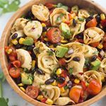 SOUTHWEST TORTELLINI PASTA SALAD is loaded with veggies and protein and coated in a deliciously simple and healthy southwest dressing Bonus that it can be made in less than  minutes Click tastesbetterfromscratch for a link to the recipehttptastesbetterfromscratchcomsouthwesttortellinipastasalad