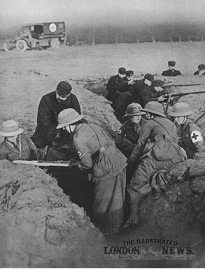 A scene in France showing members of the First-Aid Nurses' Corps bringing relief to a sufferer in the trenches.