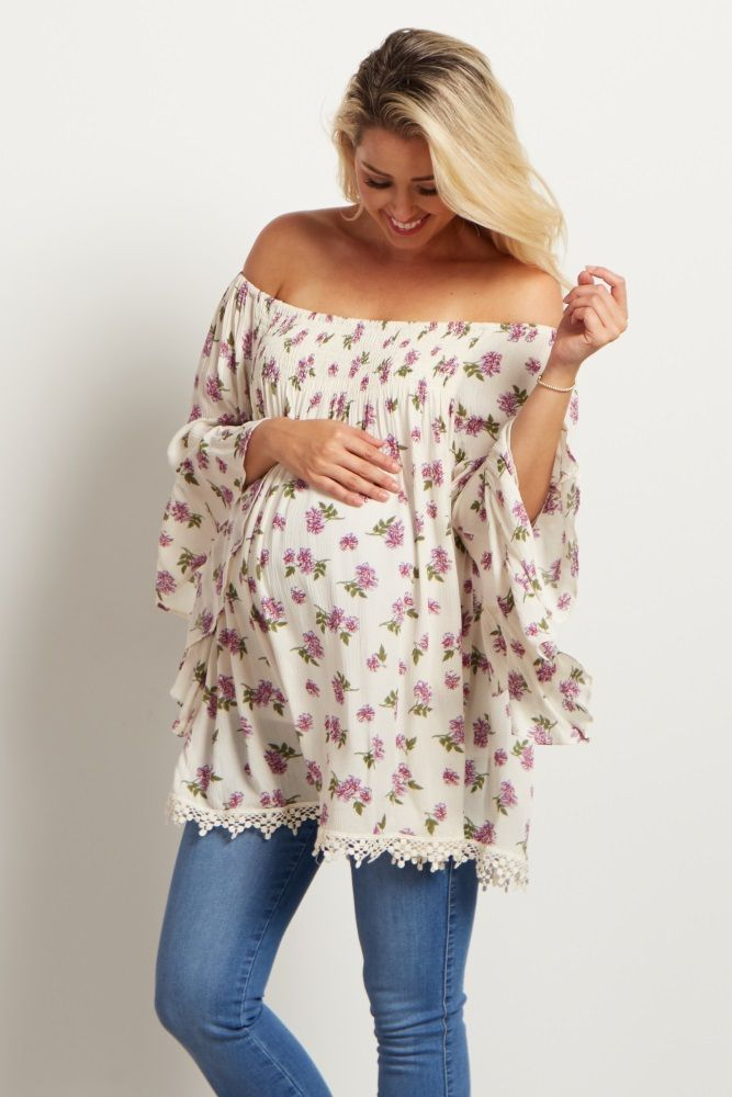 2926477605f A gorgeous floral print with a stylish off-the-shoulder detail and flowy  bell sleeves for the ultimate feminine maternity top.