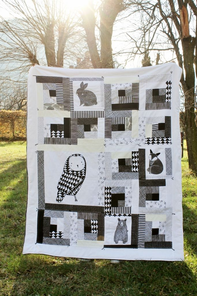 { A black and white log cabin quilt}