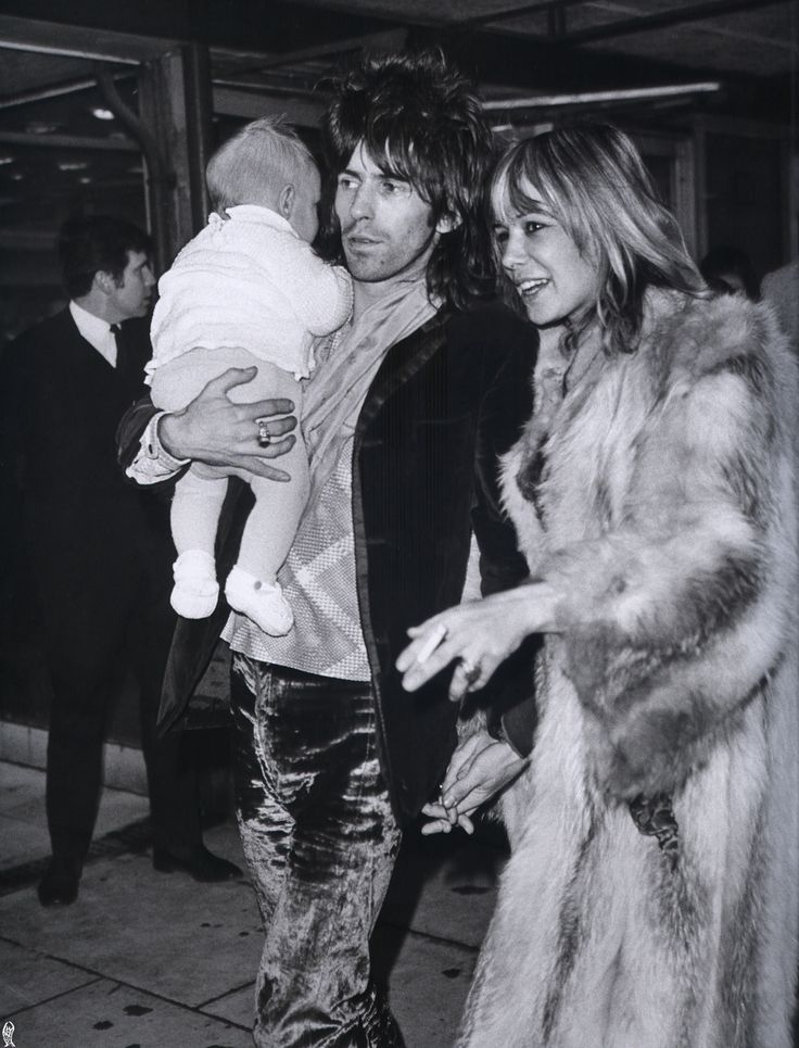Keith Richards, Anita Pallenberg and their son Marlon at the Heathrow airport; December, 1969.