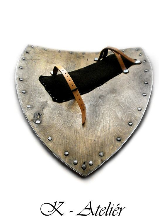 Hello, I offer this shield. It is designed for historical fencing and battle, it´s fully functional. It´s made of bonded wood veneer, with three