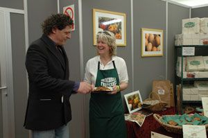 Marco-Pierre White with Mary Galbraith trying some of our 'delicious' fruitcake at the Royal Windsor Food and Drink Festival