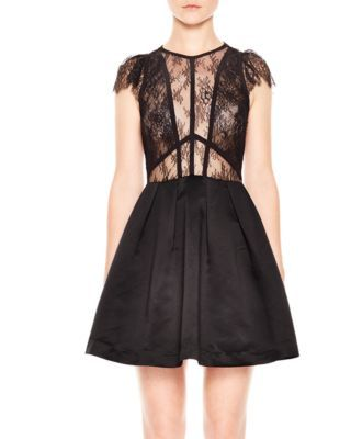 Sandro Davina Lace-Bodice Dress | Polyester; contrast: polyamide | Dry clean | Imported | Fits small, order one size up  | Designed for a slim fit | Round neck, scalloped cap sleeves, sheer lace bodic