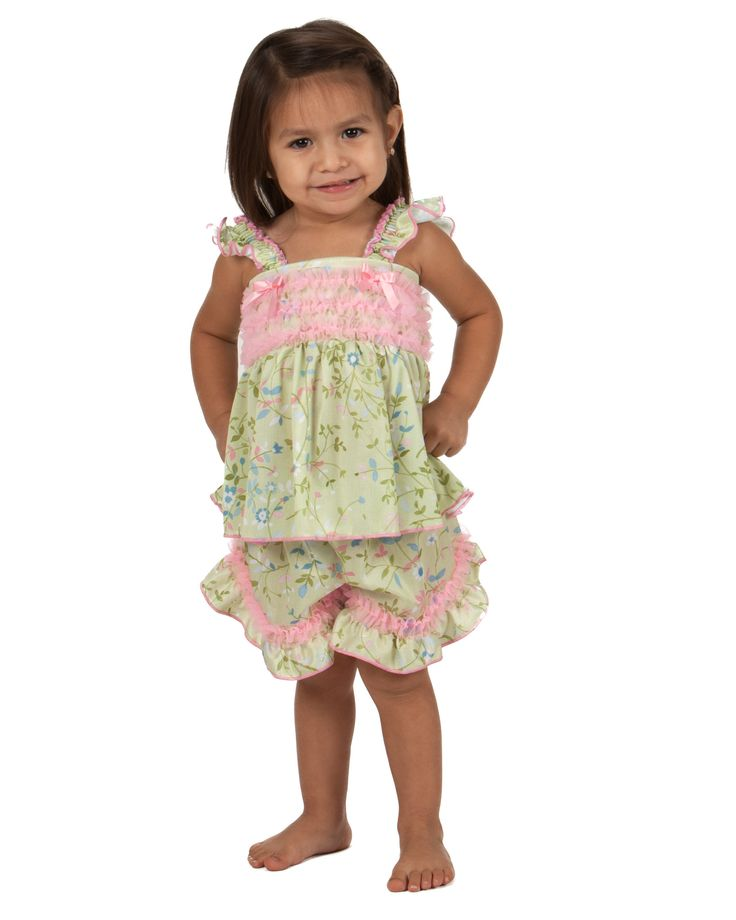 Your little girl is sure to look like royalty in the Laura Dare Garden Fairy Frilly Pajama Short Set. The set is green with a floral print and a touch of pink to represent the beautiful spring season.
