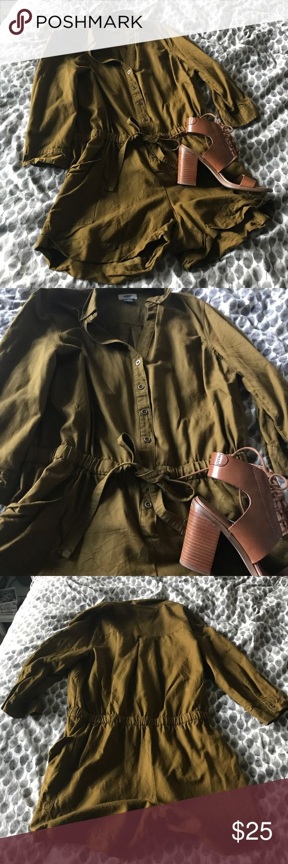 Od Navy romper Old Navy military green romper with tie waist and pockets. Button-up front leading to elastic waistband very flattering! Great piece for fall! 54% rayon, 46% cotton Old Navy Pants Jumpsuits & Rompers