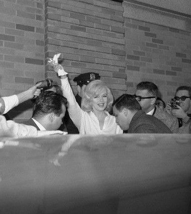 Marilyn leaving Columbia Presbyterian Hospital in New York, March 5, 1961.
