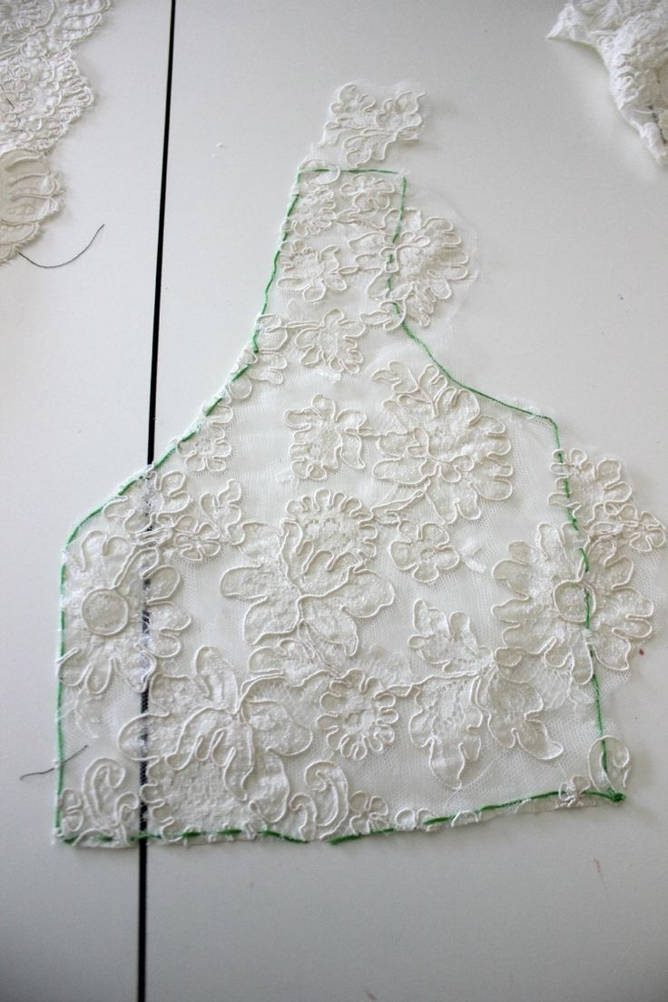 Adding A Lace Overlay To A Strapless Wedding Gown:Thread tracing and applique seams on lace