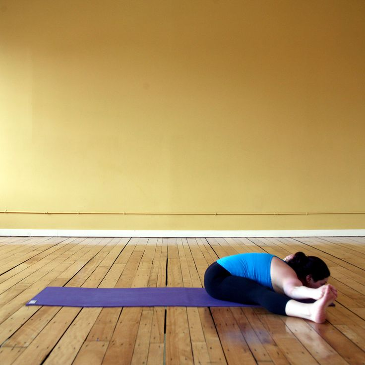 Here's another great pose that will stretch both hamstrings and your lower back. Since your legs are separated, it focuses more on the part of the hamstrings closest to your bum.   Sit down with your feet about three to four feet apart (not as wide as