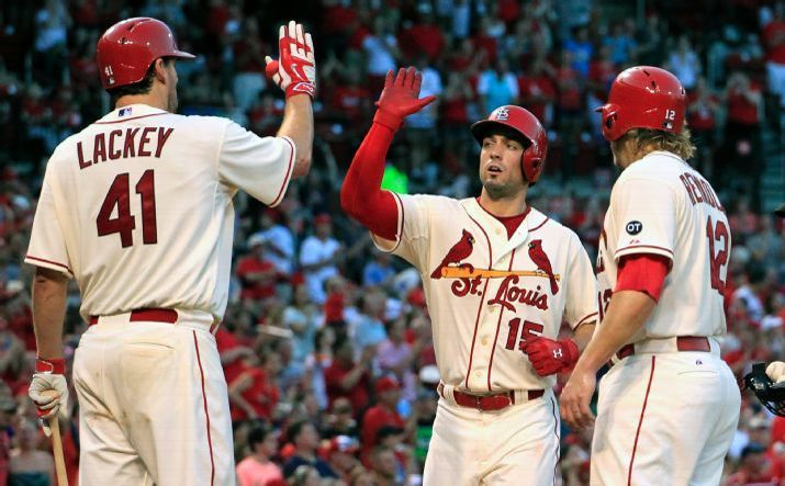 Randal Grichuk is congratulated by teammates John Lackey and Mark Reynolds after hitting a two-run home run during the fifth inning against the Mets. Cards won 12-2. 7-18-15