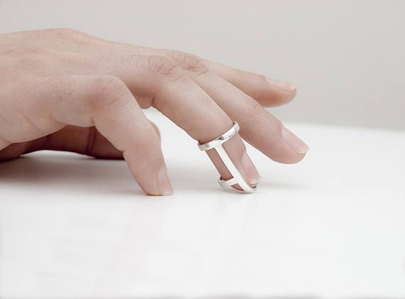 Contemporary finger splint ring for the bold one. Silver or gold filled rings to abounce all the compliments. Perfect for gift giving too. This ring fits in many finger sizes because the circle which is in the top of the ring is adjustable. You can measure your finger in the joint where
