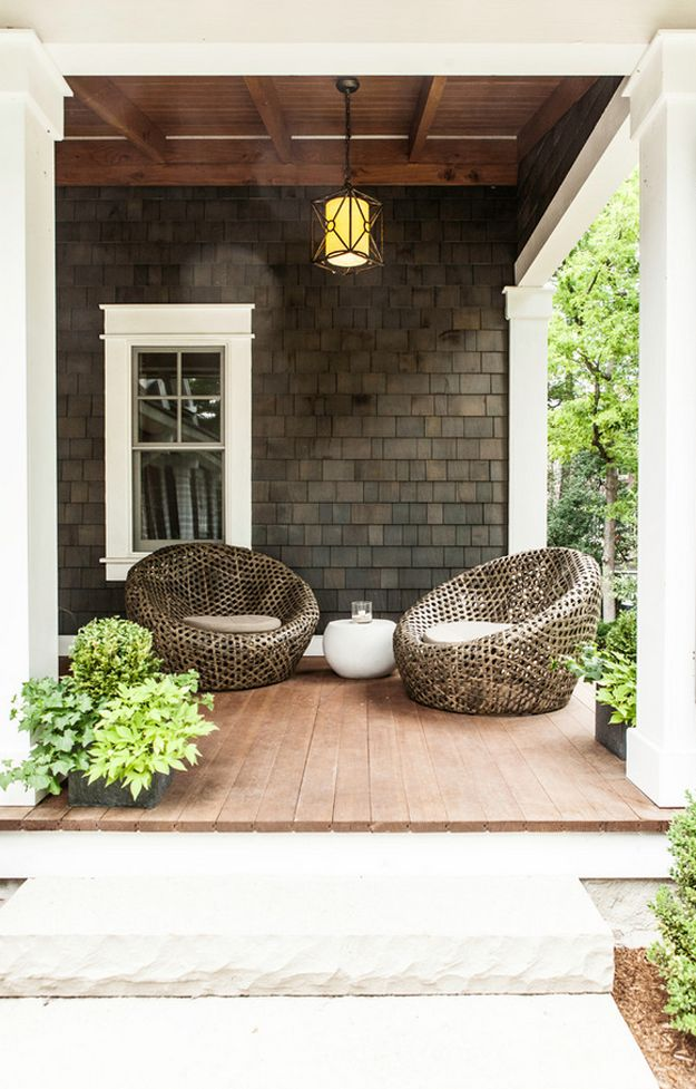 home porch exterior with dark brown shake siding, sherwin williams sealskin, dark brown, dark bronze
