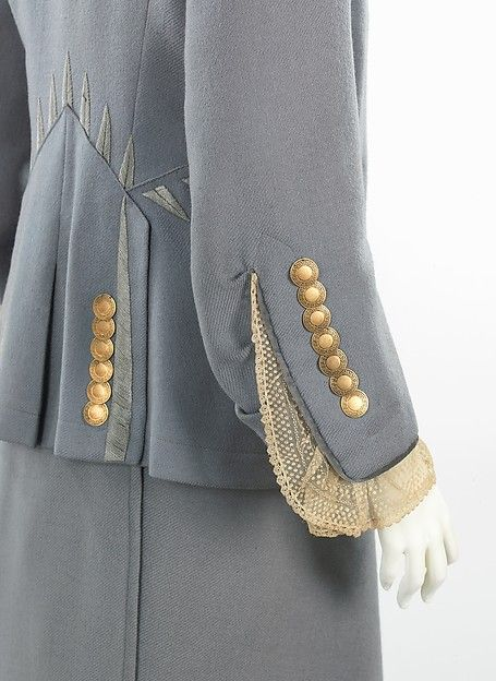 Walking suit Design House: (a–c) House of Paquin  Designer: (a–c) Mme. Jeanne Paquin  (d) Thurn Date: spring/summer 1910 Culture: French Medium: wool, metal, silk Accession Number: 2009.300.474a–d