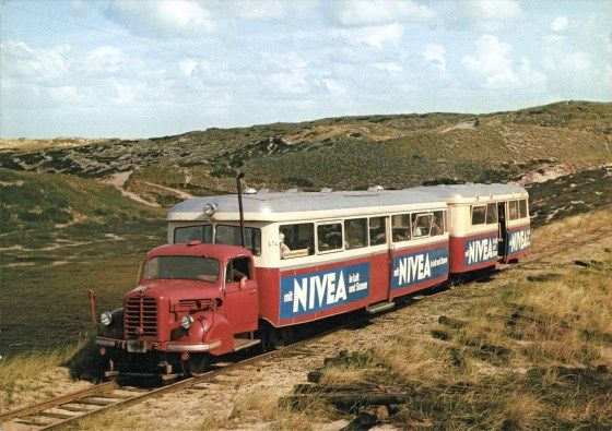 ☆MG☆The Rail Bus - Germany - Sylt  The most peculiar rail vehicle ever constructed, Nº LT 4, a Borgward truck with trailer (own construction 1954) plus separate coach. It ran on meter gauge of the Sylter Inselbahn - Railway on the isle Sylt in North Germany [ 40 km network ] till the closure in 1970. Seen in the dunes near 'Kampen' by Wolfgang Walper