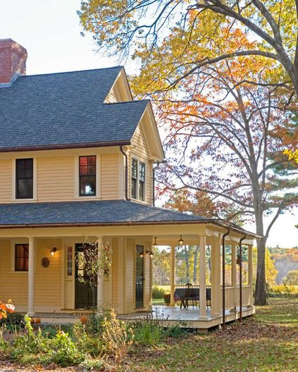 Siding paint: Hawthorne Yellow, Historical Color collection, Benjamin Moore; trim: Powder Sand, Benjamin Moore; door paint: Lafayette Green,...