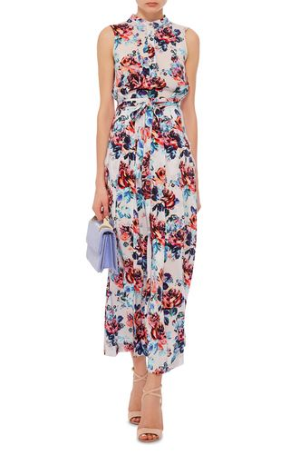 Known for her groundbreadking take on femininity, this season the London-based designer looks to the stars for cosmic inspiration. This **Mary Katrantzou** dress features a vibrant floral silk print in a sweeping maxi silhouette.