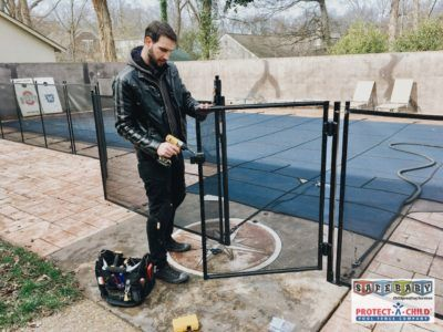 Child safety expert Jonathan, with Safe Baby Childproofing Services, assembles a Protect-a-Child removable mesh pool fence with self closing gate in Nashville, TN. Visit www.safebaby.com today to get your pool ready for summer!