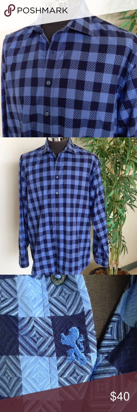 """Bugatchi Uomo Texturized Blue Plaid Shirt Such a great fabric - Exaggerated Gingham Check not quite a buffalo plaid but with texture! Great classic fit mens shirt Maker: Bugatchi Uomo Fabric: 100%  Cotton  Listed Size:  Tag is out but according to size charts 3XL Measurements: Shoulder seam to shoulder seam: 21"""" Armpit to armpit:  28"""" Sleeve length from shoulder seam: 27"""" Length: 34"""" Condition: Very good to excellent pre-owned worn used but not abused condition and coming from a non smoking…"""