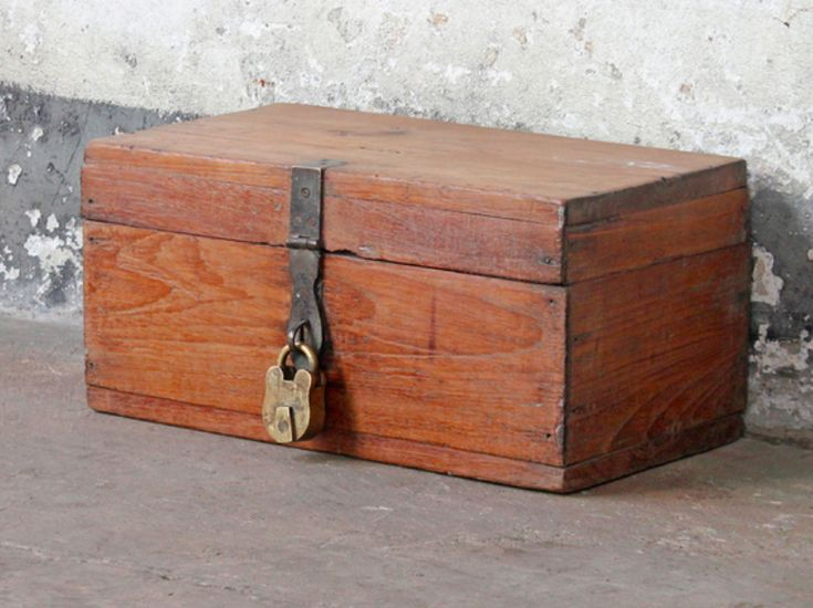 Full of authentic imperfections and a fantastic golden brown colour, this wooden vintage storage box has three secret compartments and a coin-slot reflecting its original life as a merchant's money chest. #furniture #vintagefurniture #homedecor