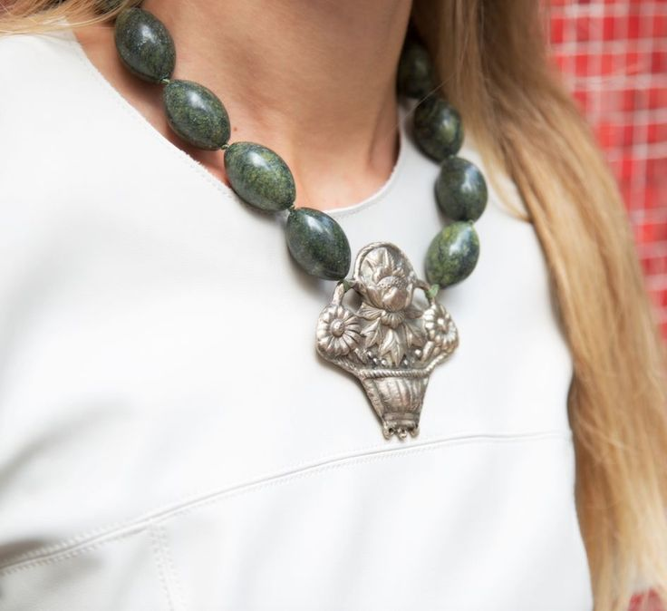 Russian Jade Necklace with Copper Basket Pendant - Heidi Carey | Deep green jade beads sourced from Russia jade mines in chunky oval tubes are hand knotted on silk cord to a statement copper pendant. Featuring a basket of fall blooms, the lightweight copper pendant adds a worldly, bohemian statement to your wardrobe perfect for adding a bit of edge to cozy fall sweaters.  #statementnecklace  #styleover40  #styleover50  #eastmeetswest  #heidicarey  #boldlyclassic