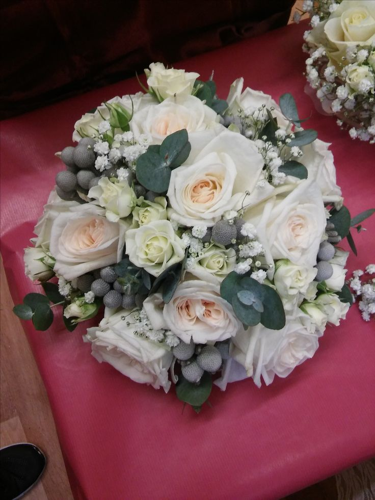 winter bouquet of white ohara roses, spray roses, gypsophila, eucalyptus, brunia berries. by fleur couture