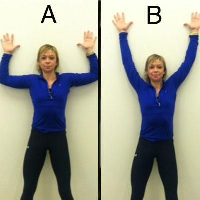 Wall angels. Start standing, feet wide, with your back against a wall, arms extended out to the side with your elbows bent 90 degrees, palms facing forward. Then, while keeping your head, spine, butt, elbows, and backs of your hands against the wall, slide your arms straight up overhead.  Do 2 sets of 15 reps