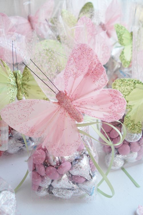 Pretty pink polka dot treat bags and some whimsical pink and green glittery butterflies.  Bags filled with Hershey's Kisses, pink M & M's and pastel candies - then add a butterfly and bow.  Love it!