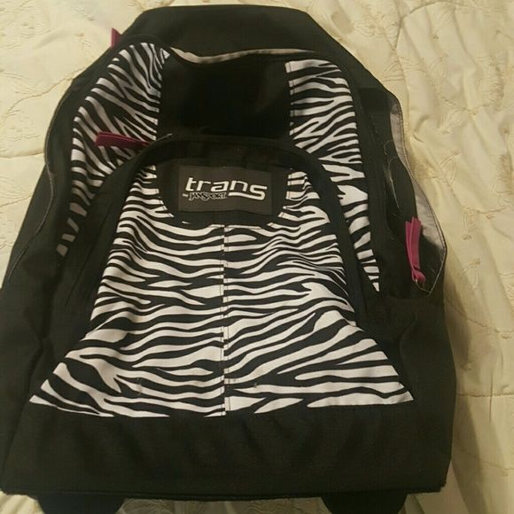 Jansport Rolling backpack Black and white print backpack with wheels. Minor wear on the bottom. Good shape. Jansport Bags Backpacks