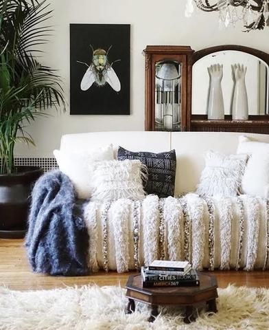 """East Perry's Large """"LuBlu"""" Throw, Knitted Gotland Throw sitting pretty in this beautiful modern living room. Perfect for your modern home interior, boho home and decor, or nursery decor. Check the link for full product info."""