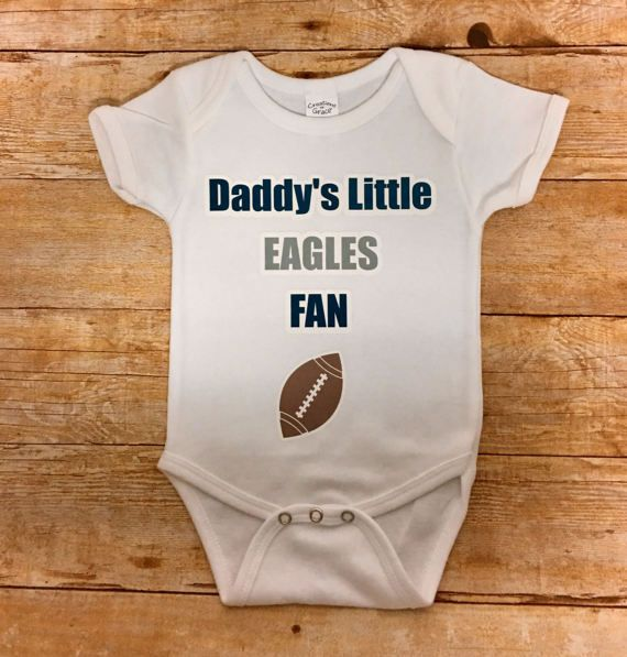 E A G L E S -- EAGLES!!!  Fly EAGLES FLY! Im from Wilmington, DE and bleed green and silver so any time I get an order for PHILADELPHIA EAGLES gear it makes me SMILE!  My daughters are always decked out in Eagles gear and now your kids can be too!!!   Daddys Little EAGLES FAN is the default image but it can be made to read Mommys, Grandpas, Grandmas, Aunt, Uncle, Godson, Godmom etc. Please leave a message in the notes or contact me if you would like a different team, color(s) or number(s) on…