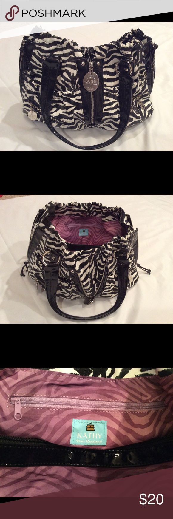 Kathy Van Zeeland purse, Zebra print. Kathy Van Zeeland Zebra print purse, size approx. H: 12in. W: 16in. D: 6in., Has 2 zippers on sides & 1 in front, designed to expand purse size.  Used only twice, in barely used condition. Kathy Van Zeeland Bags Satchels