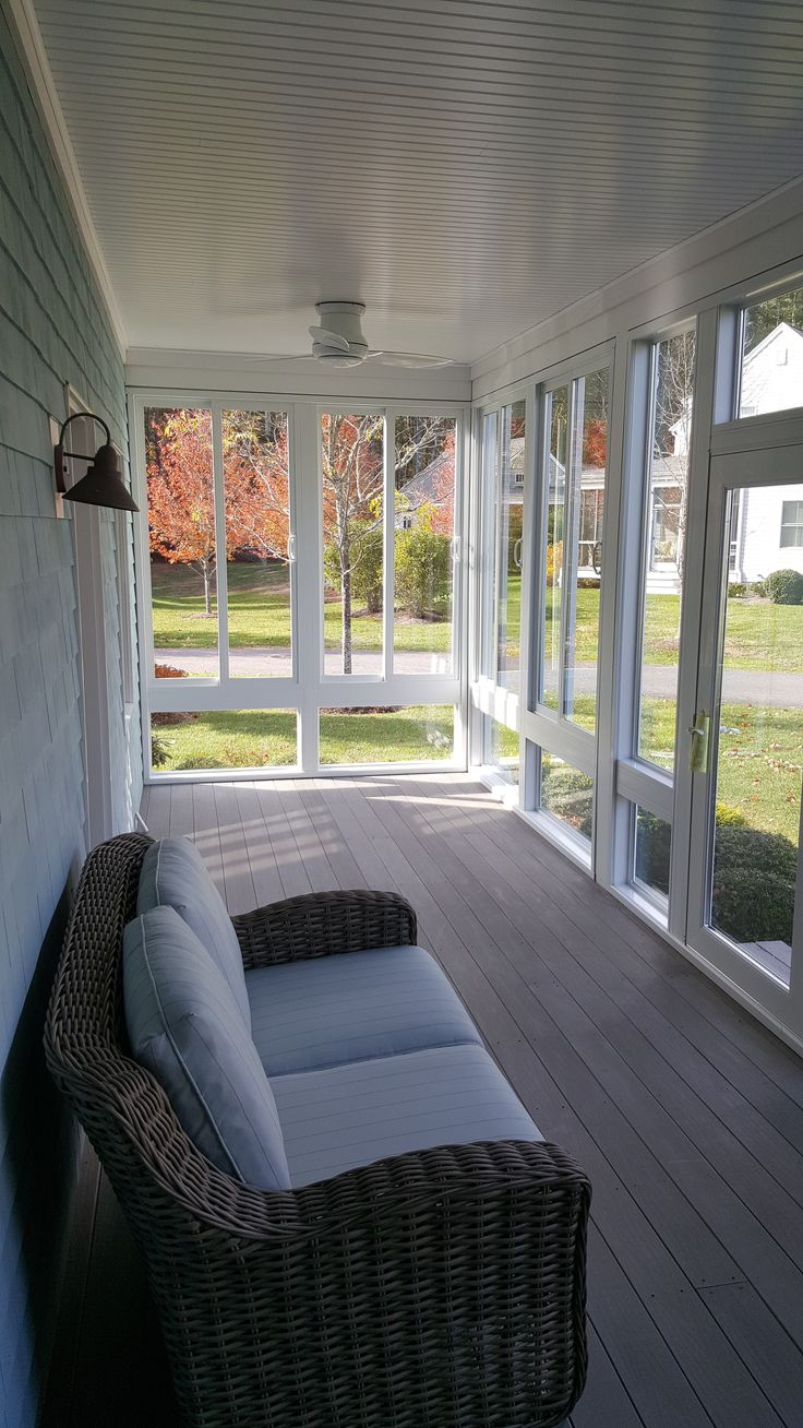 We turned an open space into a #cozy, year round enclosed porch to keep the bugs and weather out! #sunroom #home
