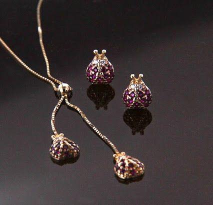 gioielli preziosi..Collana e orecchini con pietre 18kt giallo
