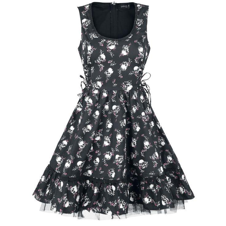 Deze jurk is niet voor zwakke zenuwen. De zwarte Side Lace-Up Dress van Gothicana by EMP met ritssluiting op de rug en vetering op de zijkanten van de taille is niet alleen met bloemetjes bedrukt. Maar ook nog met schedels, en geeft je de perfecte duistere gothic-chic look!