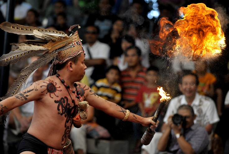A man from the Dayak tribe performs the traditional Balian dance during the Bali Art Festival in Denpasar on June 15, 2012. Traditional Dayaks believed the dance would protect them from evil spirits. (Antara Photo/Nyoman Budhiana)