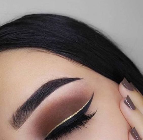 Copper Brown eye shadow perfect double winged liner gold black long lashes