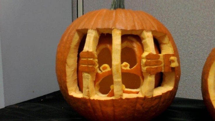 Pumpkin jail - cool pumpkin carving idea. I won first place in the contest at my work. It's a pumpkin inside of another pumpkin!! Measure the smaller one straight across then cut a hole in the back of the bigger one an just pop it inside when your done carving.