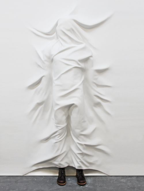 """Hiding,"" fiberglass, gypsum, paint and shoes, 86″ x 50″ x 12″, 2011 by Daniel Arsham.    I don't know why I like this so much, it is sort of creepy."