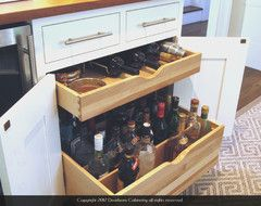 Locking base cabinet drawer system for my customers who would like to have liquor accessible for parties, but with a lock for security. It has been very popular in my bar and entertaining areas for those customers who like to keep a stocked bar. Smaller bar related items can fit on the top drawer, or wine bottles can be laid flat for short term storage.