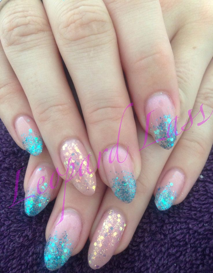 Acrylic nails with turquoise glitter fade and iridescent feature nail