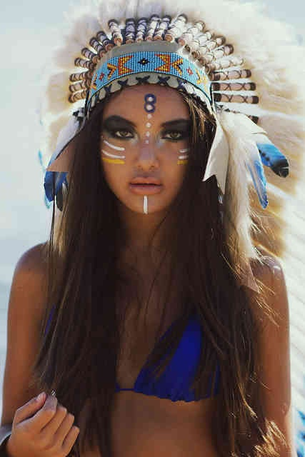 indian headress colors. the girls face looks weird. derpin